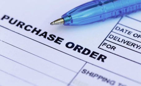 purchase order with blue pen in the office‏